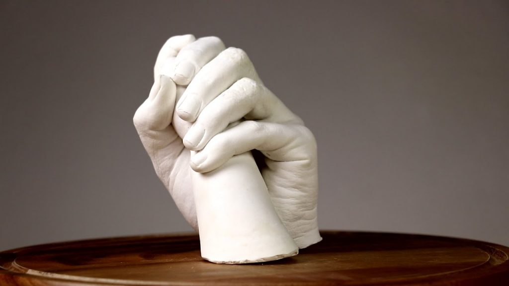 mani di cera